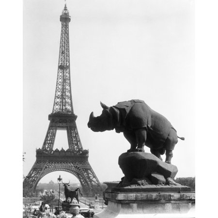 1920s Rhinoceros Statue In Foreground Eiffel Tower In Background Paris  France Rolled Canvas Art - Vintage Images ()
