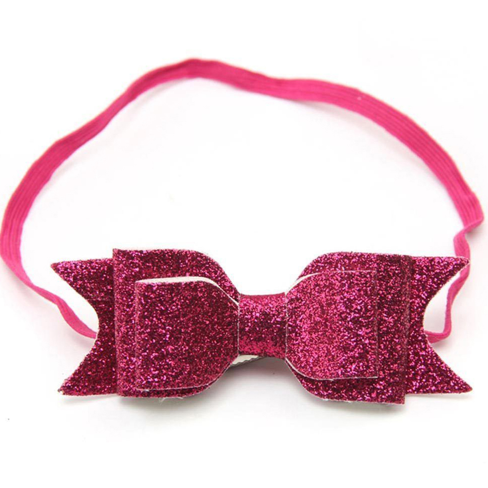 Pretty elastic hairband with glittering sequin bow.