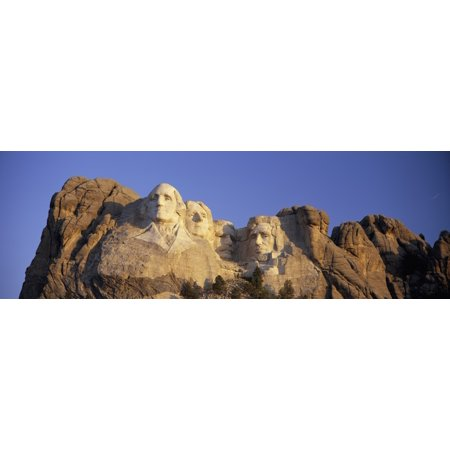 Panoramic sunrise view on Presidents George Washington Thomas Jefferson Teddy Roosevelt and Abraham Lincoln at Mount Rushmore National Memorial South Dakota Poster