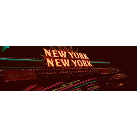 Panoramic view of New York New York hotel and casino and neon lights Las Vegas NV Poster Print