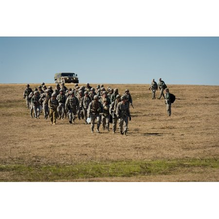LAMINATED POSTER U.S. Airmen rally at Geronimo Landing Zone during the Joint Readiness Training Center 14-03 field tr Poster Print 24 x 36