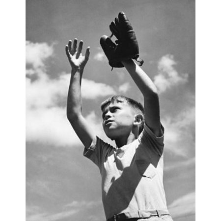 Low angle view of a boy wearing a baseball glove with his arms raised Stretched Canvas -  (24 x (Best Arm Stretches For Baseball)