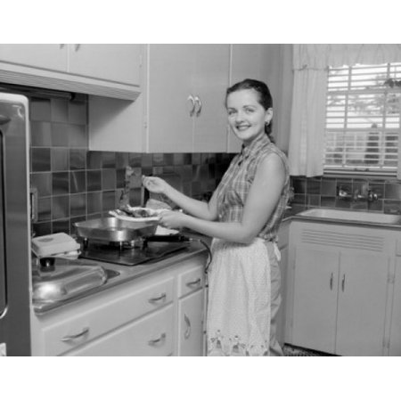 Woman Holding Plate With Food In The Kitchen And Looking At Camera Canvas Art     24 X 36