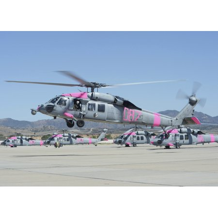 May 15 2014 - An MH-60S Sea Hawk helicopter lifts off from Camp Pendleton California to assist the California Department of Forestry and Fire Protection Poster Print