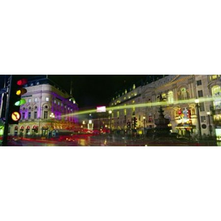 Buildings lit up at night Piccadilly Circus London England Stretched Canvas - Panoramic Images (18 x 6) ()