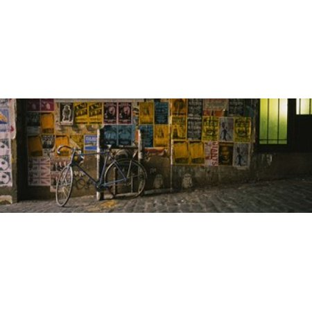 Bicycle leaning against a wall with posters in an alley Post Alley Seattle Washington State USA Canvas Art - Panoramic Images (18 x