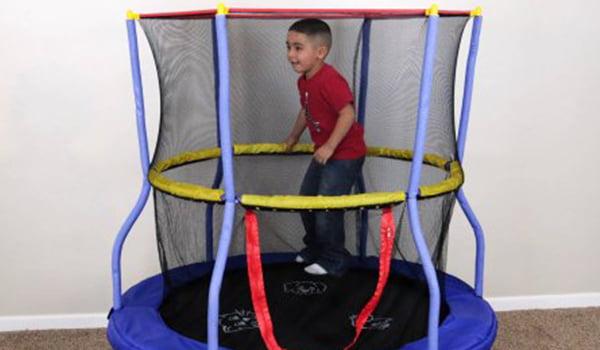 Child jumping in indoor trampoline
