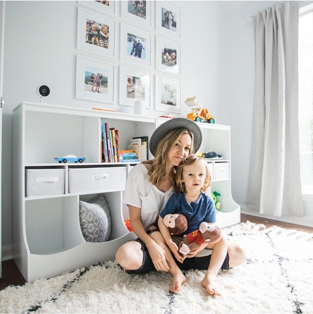 Mom, blogger and stylist Lee Anne of Life by Lee with her son in front of his new storage shelves in his big boy room