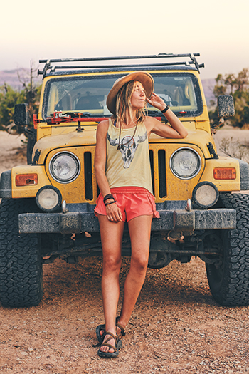 Morgan and her yellow Jeep in the desert