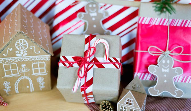 6 easy holiday gift wrapping ideas walmart close up of peppermint gift wrapped present and cardboard gingerbread house negle Choice Image