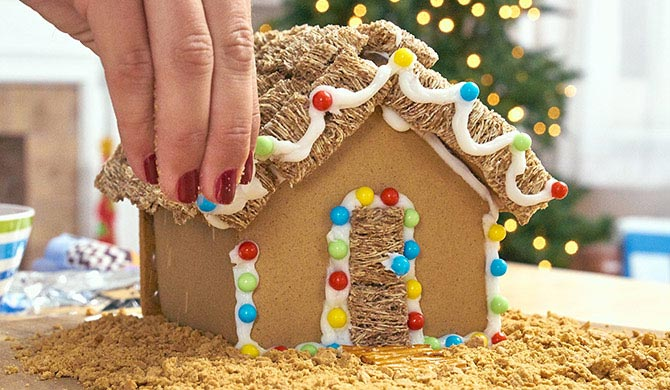 Adding brown sugar as sand to beach gingerbread house