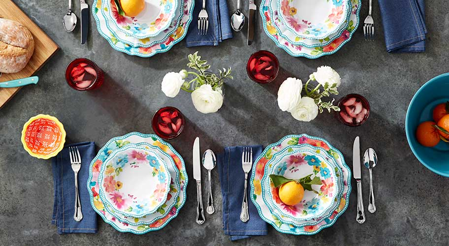 Brighten your table. Color is always in season with pretty dinnerware from The Pioneer Woman. The floral designs & scalloped details bring the garden to every meal.