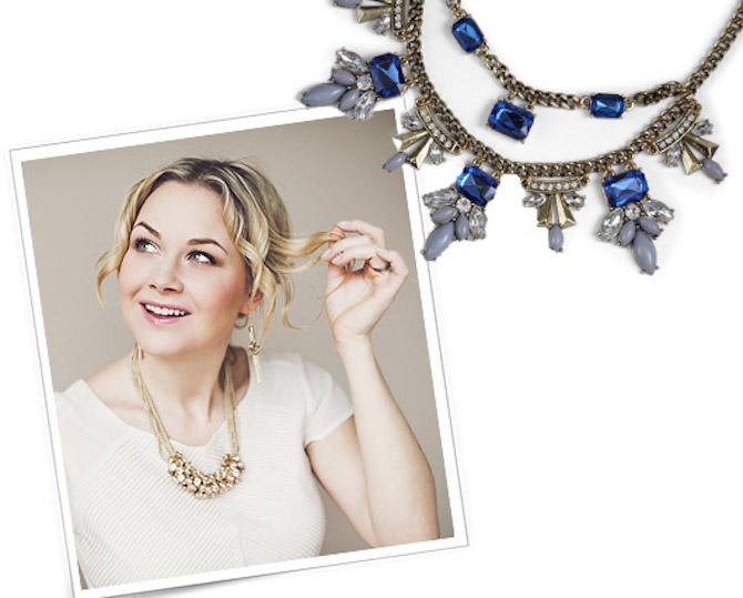 woman wearing gold statement necklace with white blouse