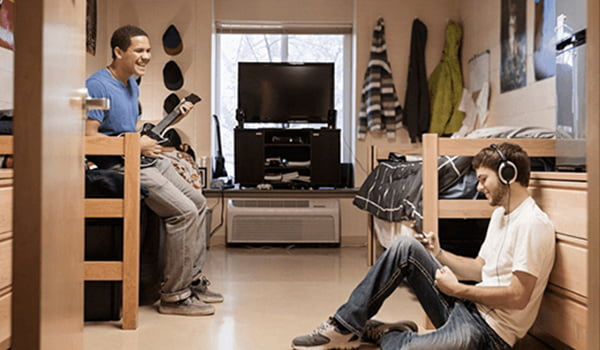 These are students using tech in a dorm room.