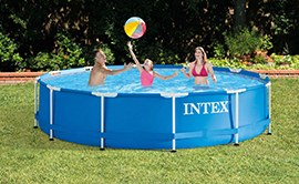 Family playing ball together in a round metal frame flexible walled above ground swimming pool