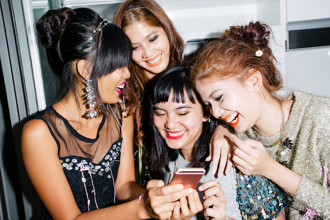 Four girls smiling and taking a selfie