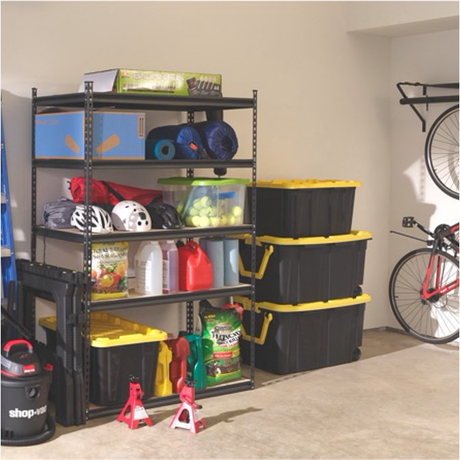 An organized garage with metal shelving, a Walmart box, and bikes hanging on the wall. Introduction to how to organize a garage.