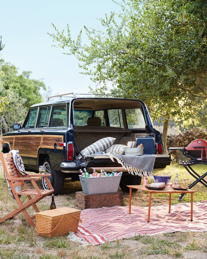 A vintage-style Volkswagon with a tailgating set up including stylish folding chairs, portable grills, and cozy outdoor decor form Walmart.com