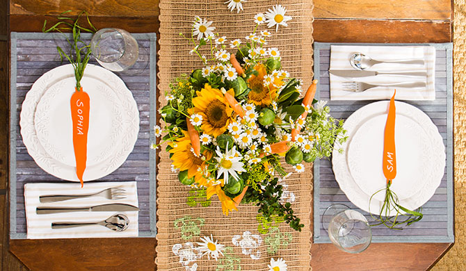 Overhead Image Of 2 Table Settings With Carrot Name Cards U0026 Flowers In Vase