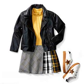 Kids' new arrivals. Multi-colored plaid skirt with yellow shirt and leather jacket. Featuring white tennis shoes.