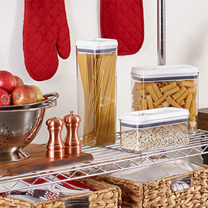 Plastic food containers on metal shelf