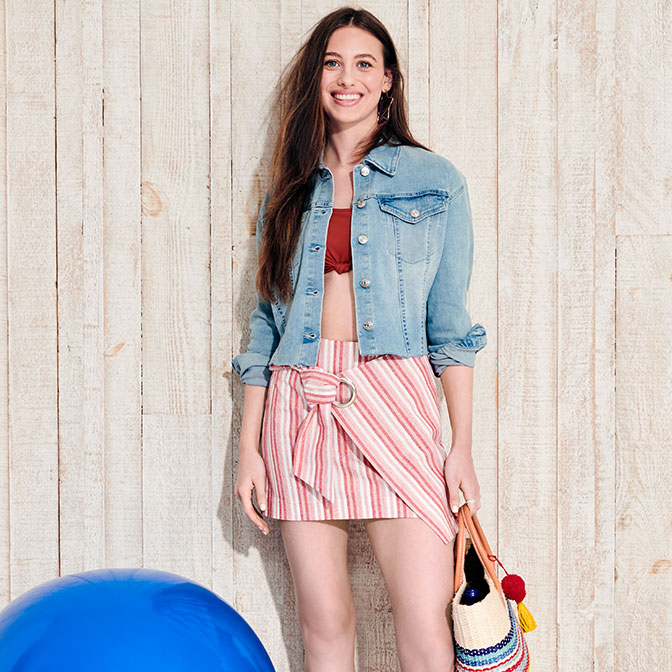 3bbaeadbed A red, striped skirt with a denim jacket. Americana accessories. White  sandals ...