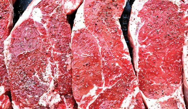 Marbled raw steaks