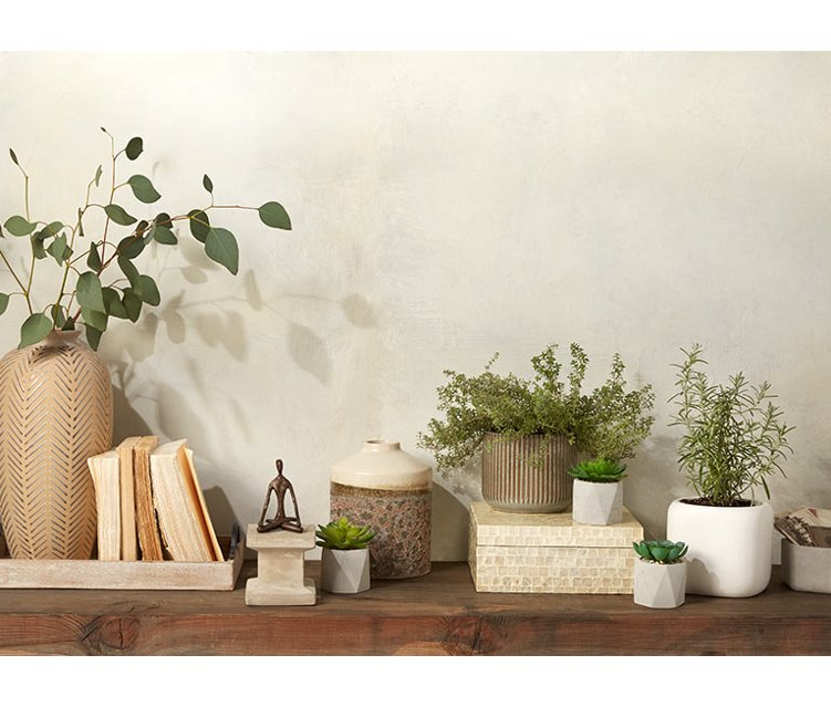 A Balanced Home Natural Neutrals Like Calming Stone Accents Faux Greenery And Boho Decor