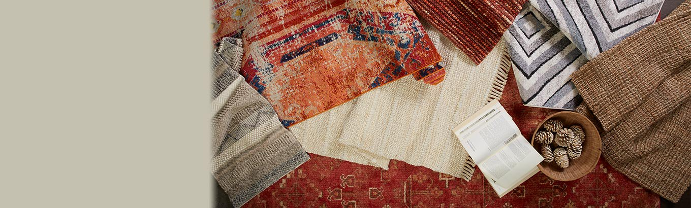 Rug refresh. Shop earthy reds and honey tones for fall.