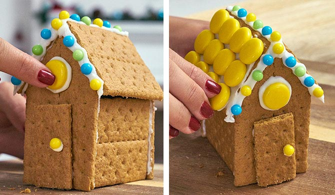 Adding candy to graham cracker candy house