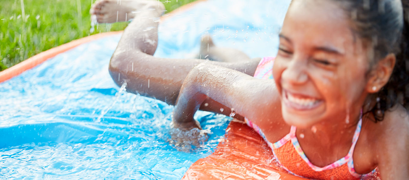 Let 'Em Slide. Keep your kids super cool this summer with a water slide to frolic on for hours of fun.