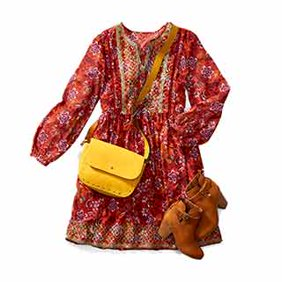 Women's new arrivals. Multi-colored bohemian dress with a bright suede bag and neutral booties