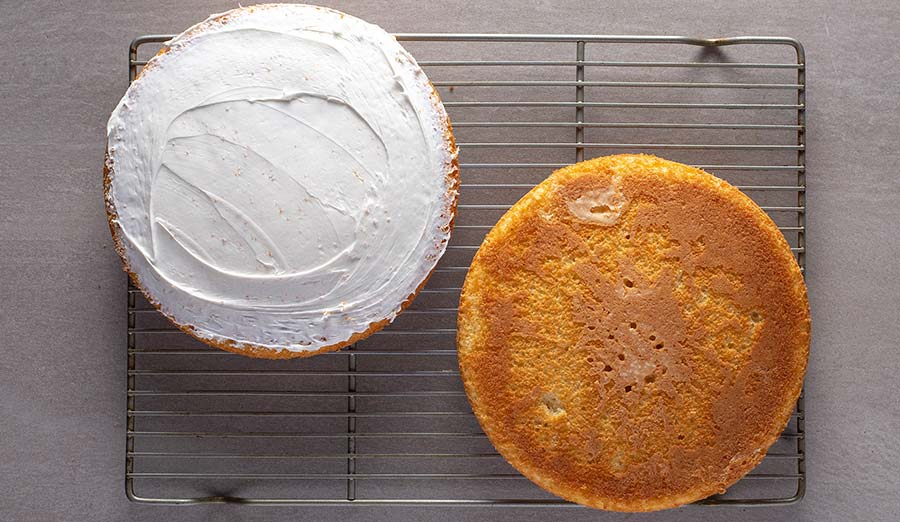Step 1 bake and cool cake, thinly frost one side