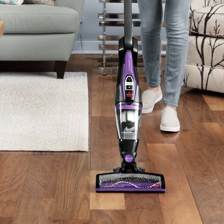 A vacuum cleaning hard floors and cleaning carpets showcasing which vacuums are best for multi-surface homes. Links to a blog post about which vacuums are best for cleaning hard floors and carpets