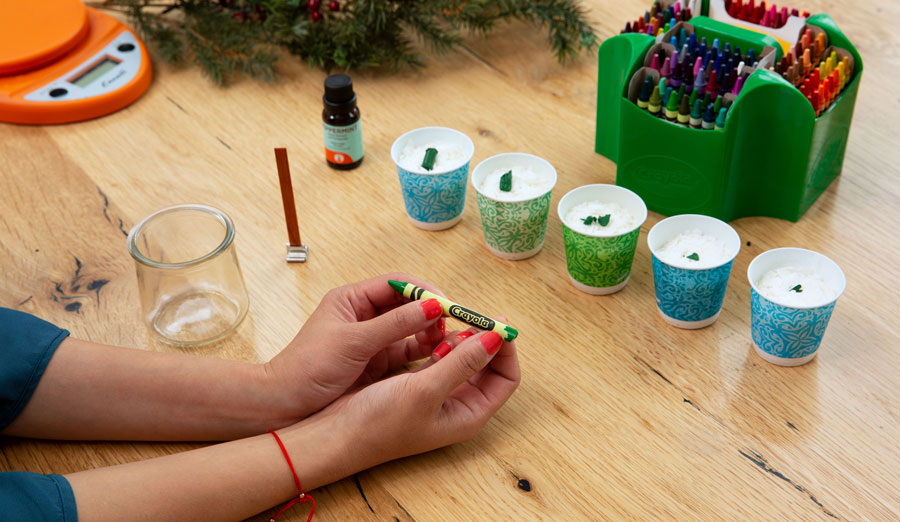 Preparing to make candles with crayons and soy wax