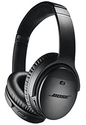 Bose quiet comfort wireless headphones - looking at black headphones from the side, can see BOSE on the side and padding for ears.