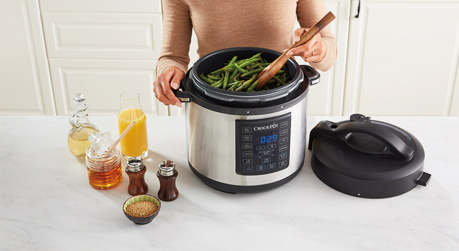 woman cooking beans in crock pot