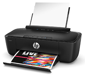 HP AMP 100 printer - a black printer with white paper in the feeder tray and a brightly colored page being printed - HP AMP also includes a bluetooth speaker on the top of the printer