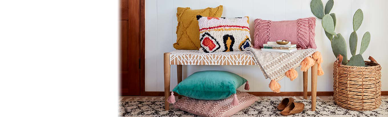 Bohemian dreams. Textiles nine dollars and up. Cozy pillows, curtains, throws, and more for less.