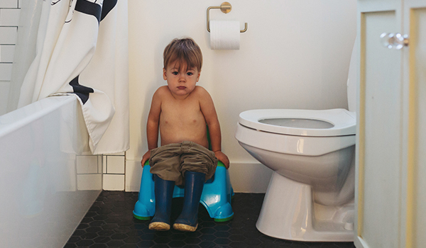 Toddler on potty in bathroom
