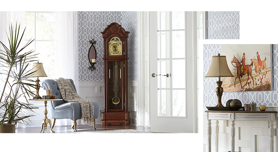 A traditional elegant entryway with a tufted accent chair, grandfather clock and decorative wallpaper. Links to where to shop for traditional home design.
