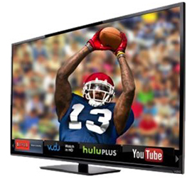 Large high definition television showing a football player catching a football