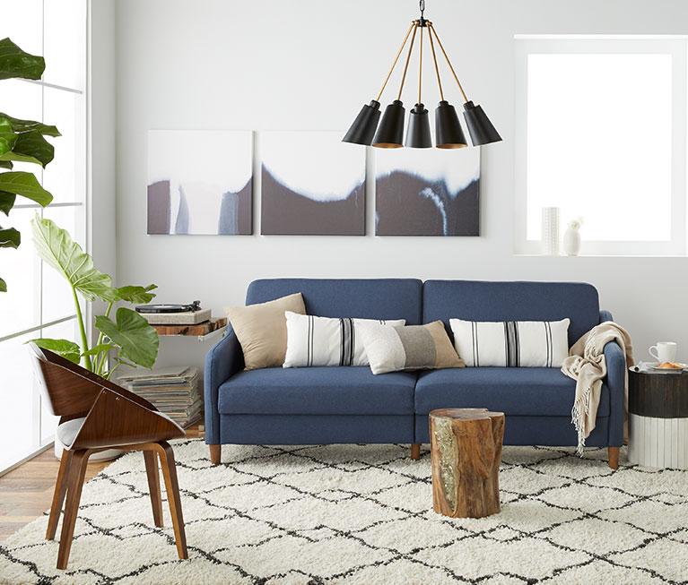 A Modern Natural Living Room With Modern Furniture And Live Edge Accents  Like A Tree