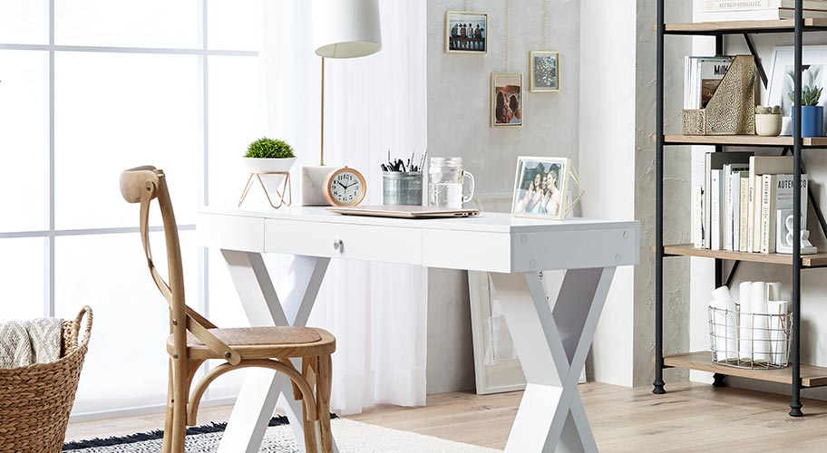 A modern farmhouse style home office with elegant office furniture & warm rustic storage and accents. Links to where to buy modern farmhouse office furniture and accessories.