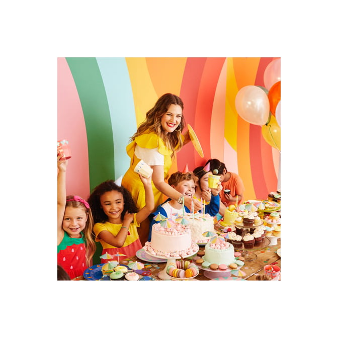 Drew Barrymore at a kid's birthday party in a rainbow room.