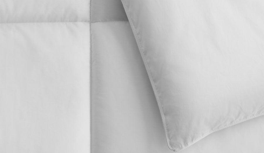 Close up on box stitch construction on white duvet comforter