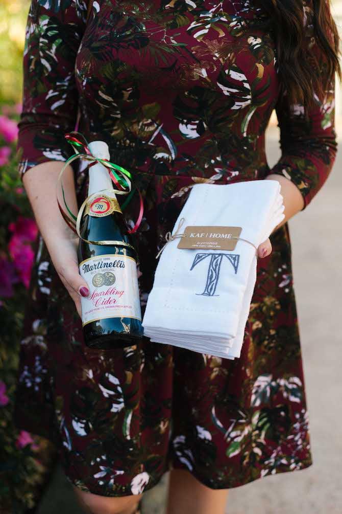 A bottle of sparkling cider and monogrammed towels