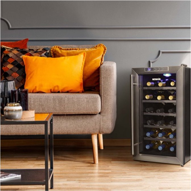 Wine cooler next to a sofa in a small-space living room. Links to where to shop wine coolers.