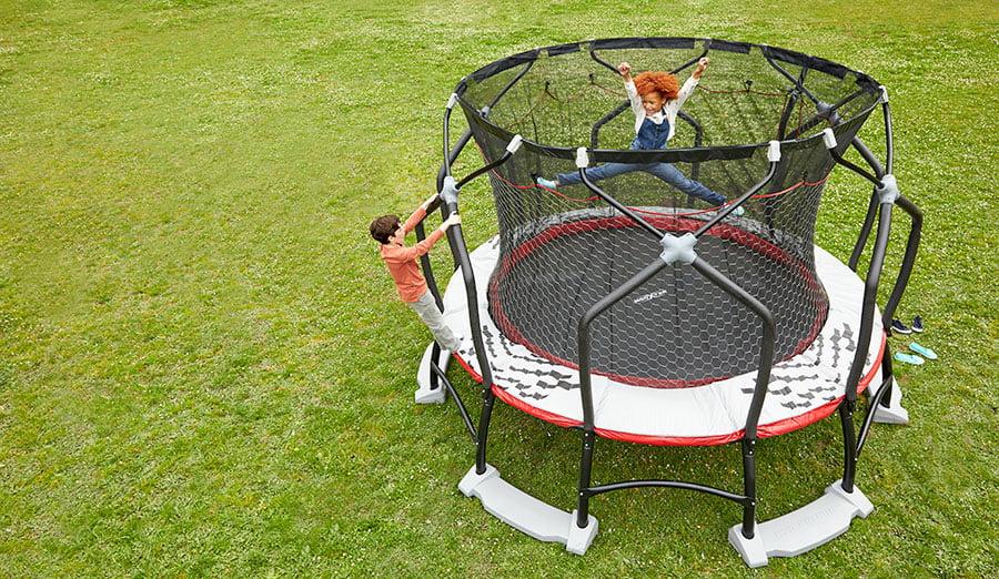 Enjoying an outdoor trampoline in an open space.