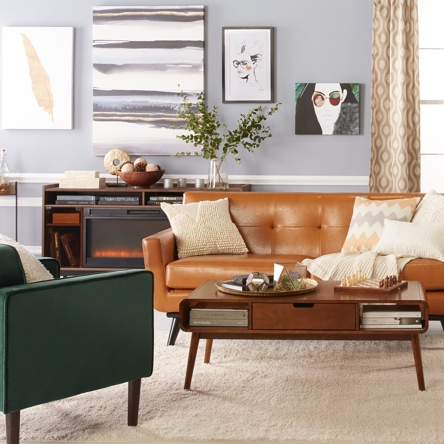 A Mid Century Modern Style Living Room With A Camel Leather Sofa, Green  Accent